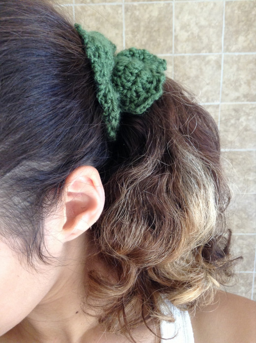 Crochet a full bunch of hair elastic scrunchies to match everything in your wardrobe!  Haha.