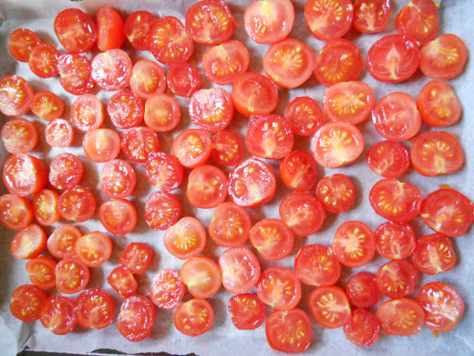 Cherry tomatoes, halved and laid out on a baking tray ready for drying