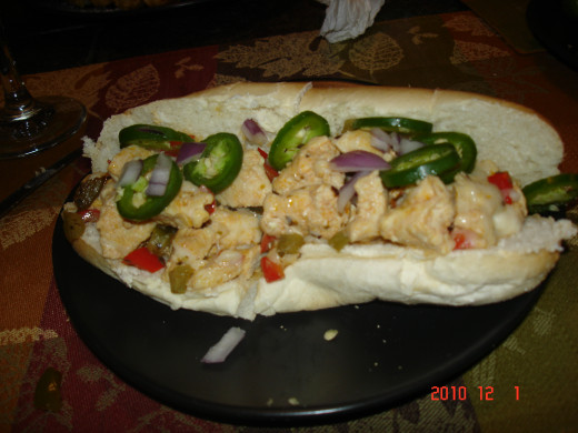Chicken, white american cheese, jalapeno peppers, peppers and raw onion