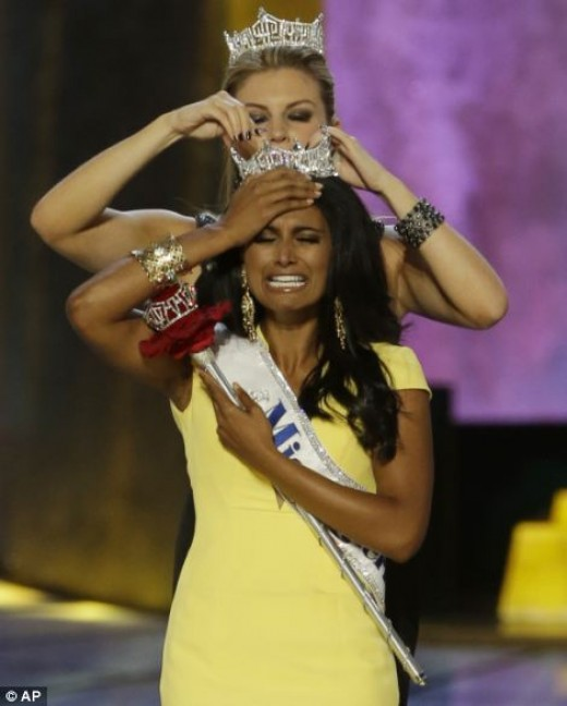 Passing on the Ms. America crown: Ms. Hagan crowning Ms. Davuluri (both are Ms. New York)