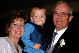 Groom's parents with grandchild (I wonder what he is thinking)