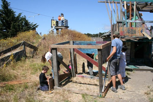 Kid-built fort at the Berkely Adventure Playground; notice the zip-line in the top left of photo.