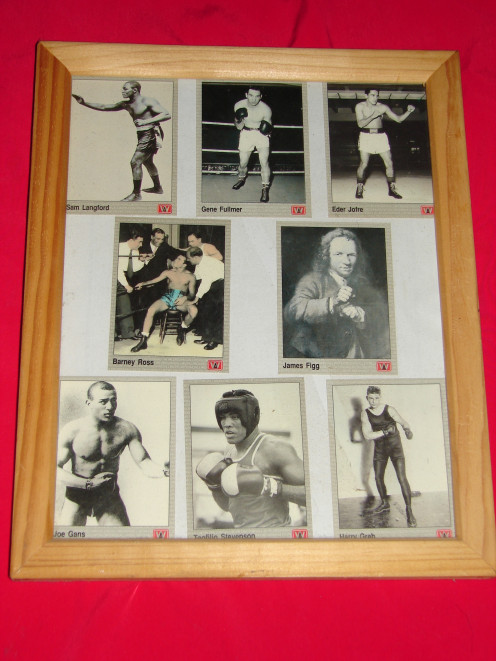 Eight classic world boxing cards. I keep my cards in picture frames and plastic covers to help preserve them.