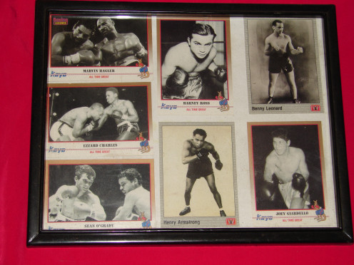 Five Kayo Cards and two World Boxing cards. The back of these cards shows the boxers fight record and has commentary on each boxer.