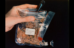 Pictured here is a sample of space food carried on the Apollo 11 lunar mission. This package contains beef with vegetables but do you know what the first food eaten by an American astronaut was?