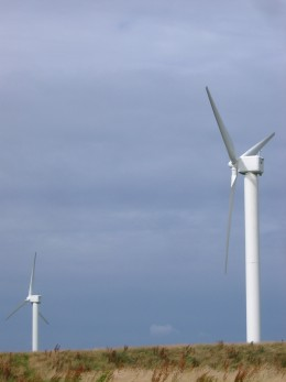 The modern way to use the wind to produce renewable energy - wind turbines.