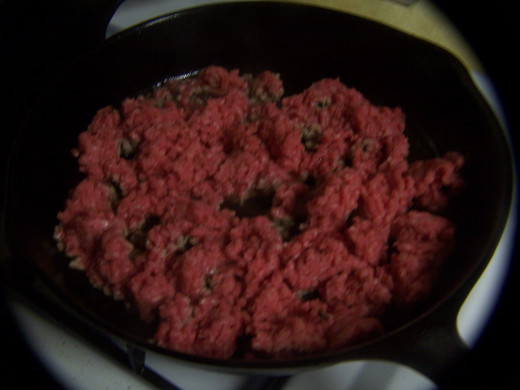 Ground beef cooking.