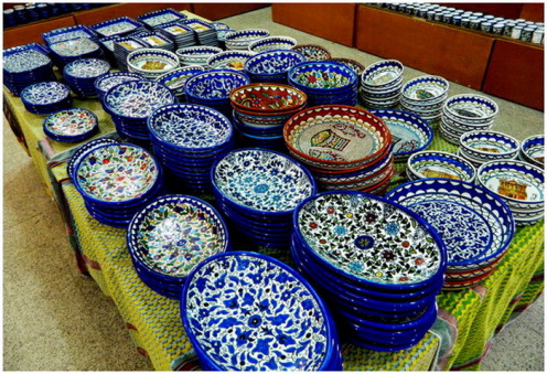 Blue wall hanging plates on display - Hand painted