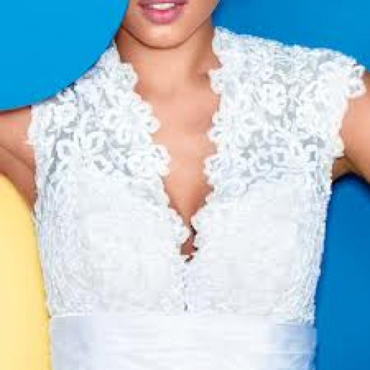 Choose a neckline that will compliment your bust and not over emphasize.