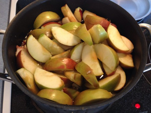 Boil cored apples.
