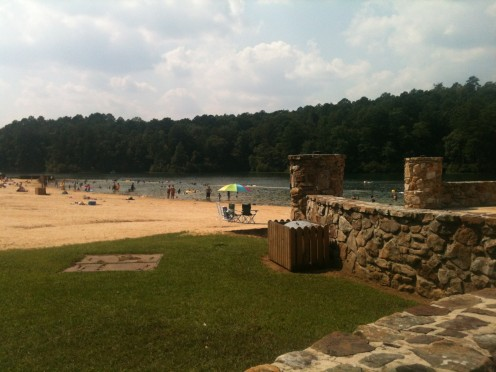 This is a picture of the beach area at Oak Mountain State Park. It has covered areas for grilling out.