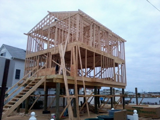 Three days into framing and the 2nd floor and roof rafters are up.