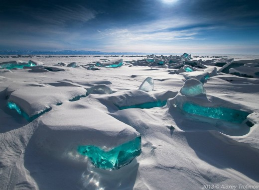 Amazing turquoise solid ice on northern part of lake Baikal during winter season