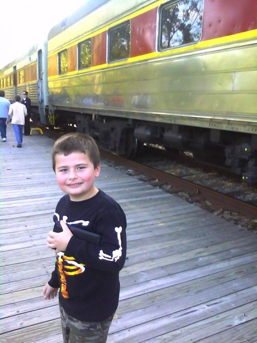 Our son, excited to get on the train!