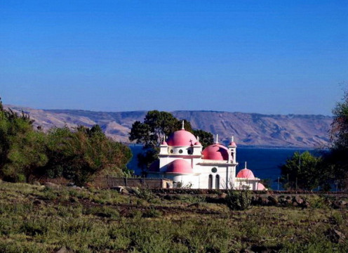 """Red domed white color Greek orthodox church on the bank of  """"Sea of Galilee"""""""
