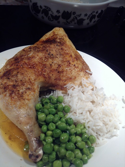 Chicken Leg Quarter with sweet chili seasoning, peas, and basmati rice
