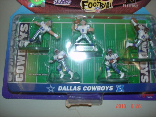 These five players #84 - Jay Novacek, #8 - Troy Aikman, #21 - Deion Sanders, #88 - Michael Irvin, #22 - Emmitt Smith all hang in my sports Den