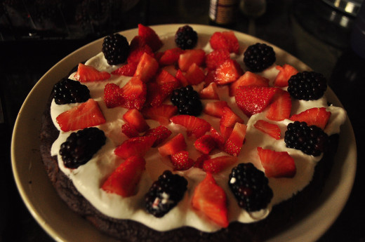 Arrange fruit on top of whipped cream