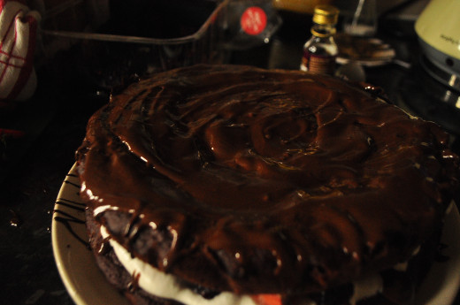 Place second cake on top and cover with melted chocolate