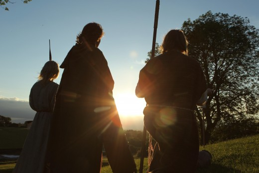 Re-enactors at the Navan Centre near sunset. In engaging to live life as their ancestors knew it, they allow a younger generation an insight into Irish/Gaelic history