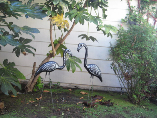 Skeleton flamingos add a whimsical touch to the Halloween decor.