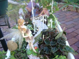 This standing fairy goes well on the path with a taller trellis. It is important to keep the accessories in line with the size of your garden.