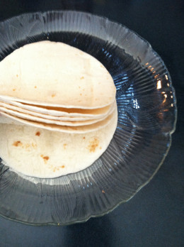 6 flour tortillas generously greased and stacked neatly.