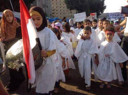 Egyptian Children dressed in 'white death shrouds' at a pro-Morsi demonstration