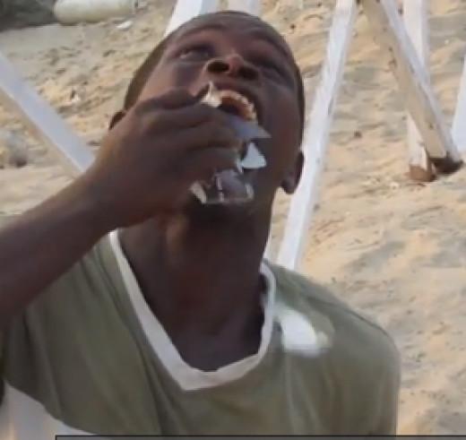 Man Eats Broken Glass