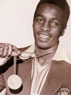 Young Seales and his gold medal