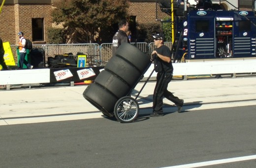 Goodyear tires rolling to another race car