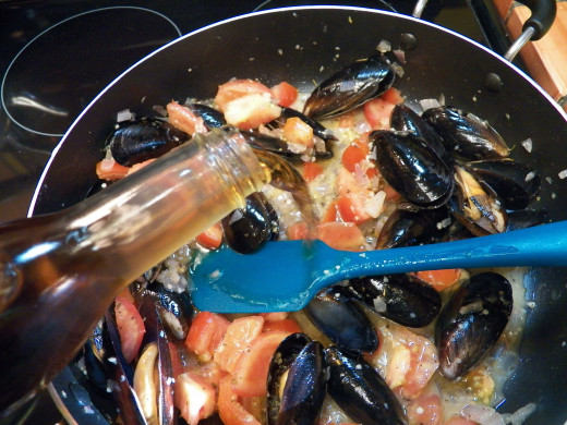 Add wine to seafood pasta.  If you want more sauce, you can add more wine and boullion.