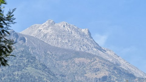 The recent appearance  of  Mt. Merapi peak in October 2013 after several eruptions.