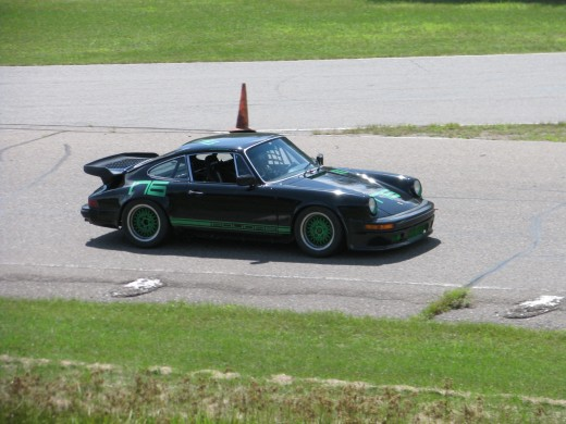 Porsche 911 on the racetrack. Can you tell if the car is moving or not?
