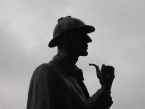 Mr. Sherlock Holmes. The figure stands watch at Baker Street tube station in London. First appearing in the laste 1880s, he is more famous than Star Trek in the 2010s.