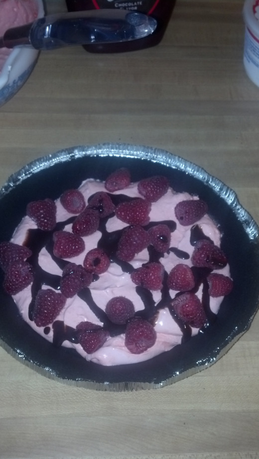 Add raspberries and chocolate syrup