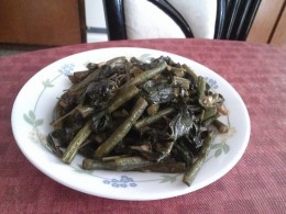 Sauteed jute leaves and long beans in soy sauce.