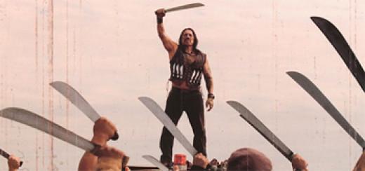 Machete (Danny Trejo) celebrates with his followers