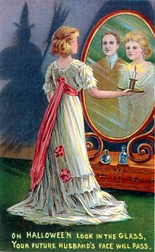 Divination rituals such as the one depicted on this early 20th-century Halloween greeting card, where a woman stares into a mirror in a darkened room to catch a glimpse of the face of her future husband while a witch lurks in the shadows, may be one