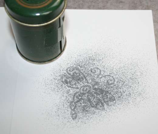Using embossing powder to cover embossed image.