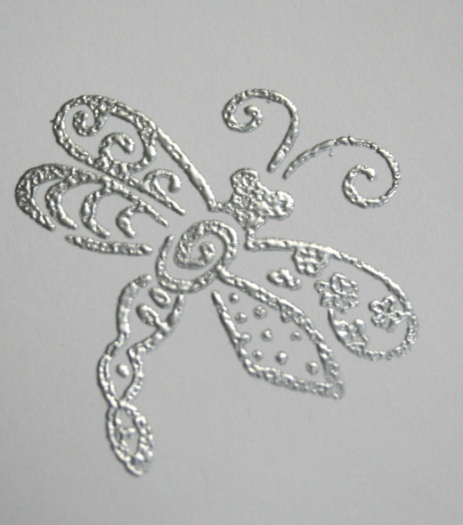 Embossed image after powder is melted.