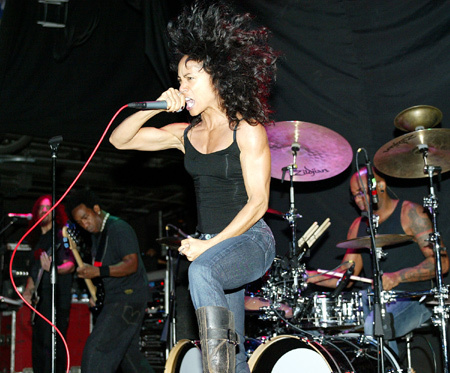 Jada Pinkett Smith performing with her band Wicked Wisdom