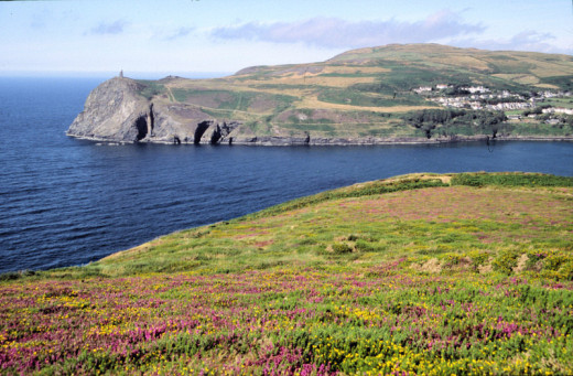 The Manx coast cliffs would have looked forbidding to those who plied the sea in coracles, until seafarers came to where the harbour towns of Douglas, Port Erin and Peel were later established