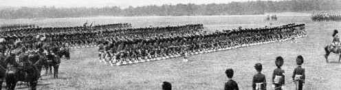 March-past of the 1st Battalion Gordon Highlanders with their colours. At the time, one of the few remaining sights of martial pageantry.