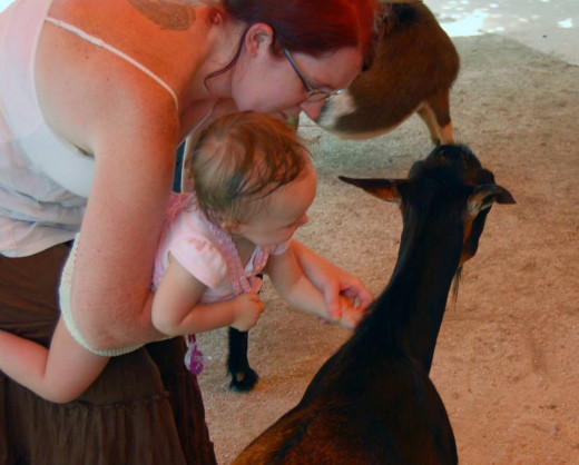 Me with my youngest daughter in the petting zoo. photo by AMB