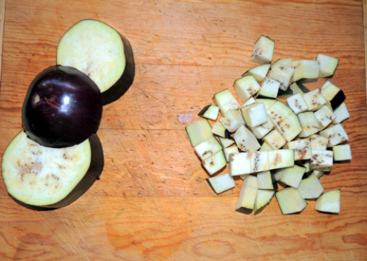 Meantime, prep your eggplant. It browns quickly so that is why this step is left until the last minute. Cut into ½ inch chunks, peel on.