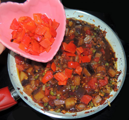 add broiled red peppers. Stir and remove from heat
