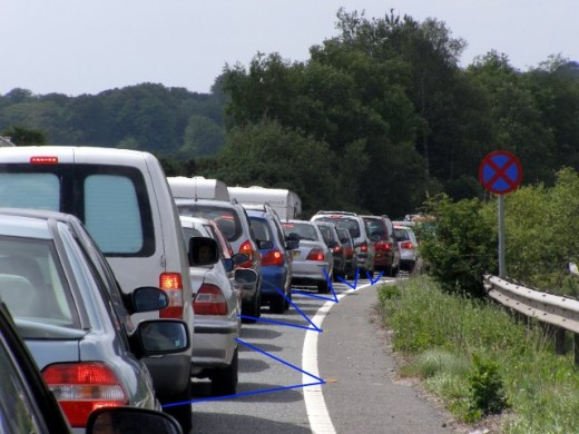 Transponders in the line markers receive and respond with signals that can be interpreted as distances to the car, and so keep the car within the lane even around bends
