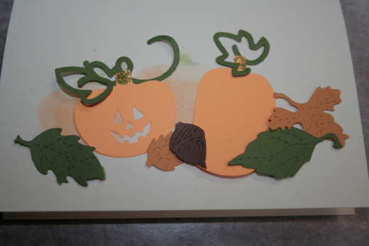 Pumpkins, leaves, and vine die cut shapes.