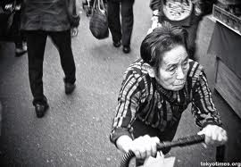 An old lady on a shopping trip in the Sugamo District.